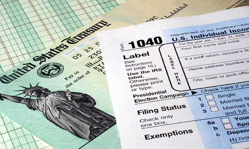 Close up of IRS check and 1040 form